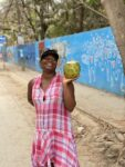 Mawa posing with a coconut